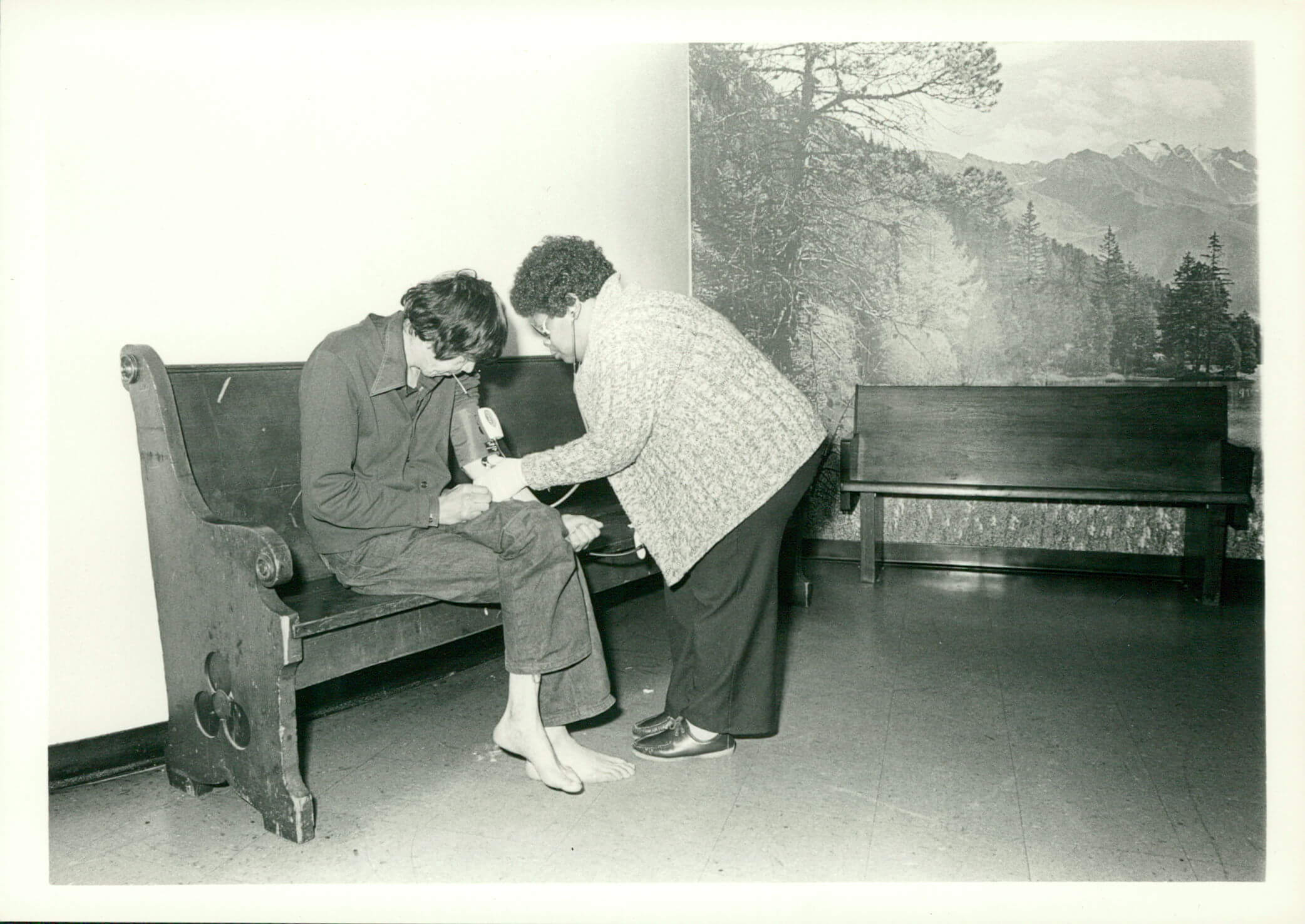 Medial working taking blood pressure of another woman in the 80s
