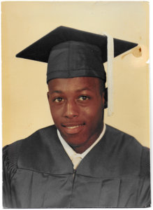 Young man in a graduation cap and gown