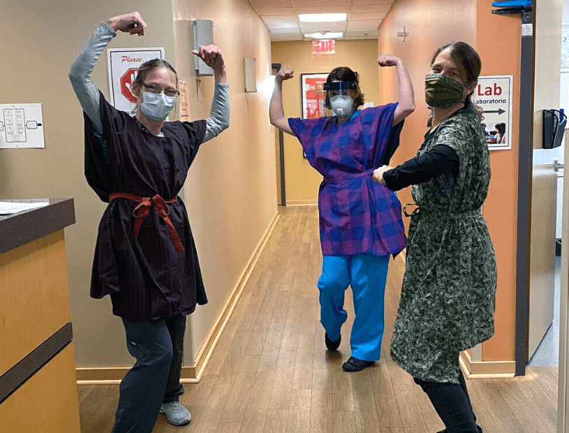 Kim Hutchinson, RN (at far right); Simone Vining, Medical Assistant; and Kimberly McKay, Medical Assistant show off their new protective ponchos.