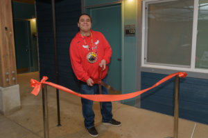 Jerrod smiles as he cuts the ribbon at the grand opening of Hazel Heights apartments in 2018.