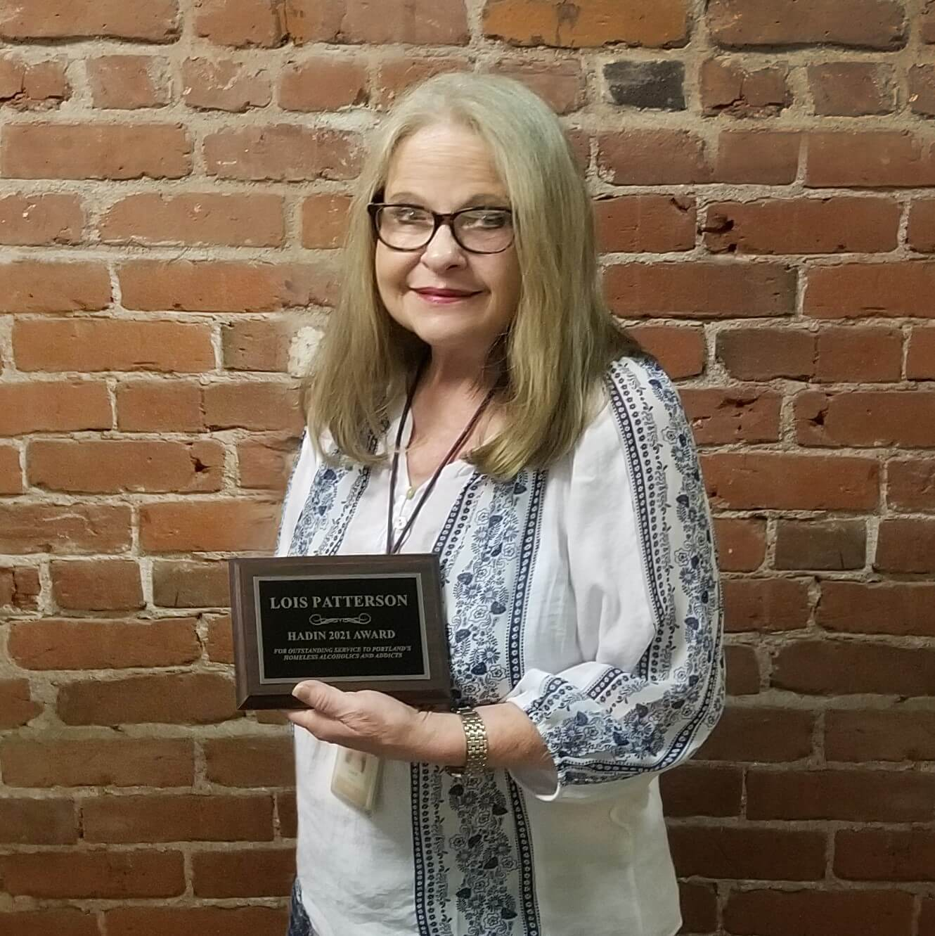 Lois Patterson holds her HADIN award.