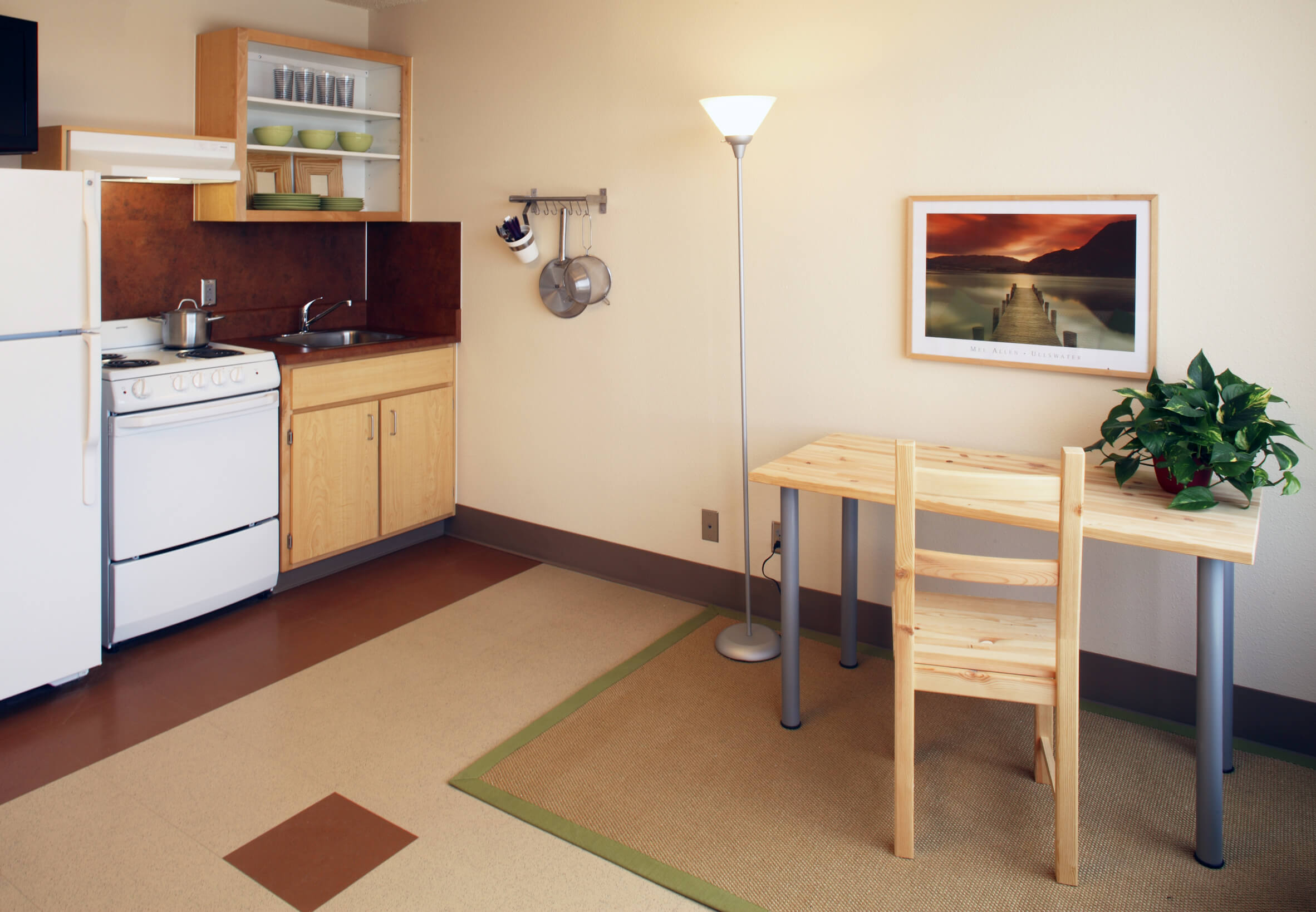 Interior of single apartment in Madrona Studios showing kitchen and dinning table